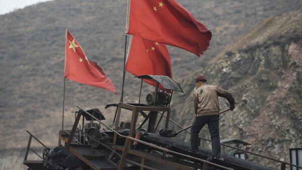 Рабочий угольной шахты в Датуне, Китай