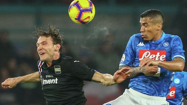Sampdoria's Swiss midfielder Albin Ekdal (L) and Napoli's Brazilian midfielder Allan go for a header during the Italian Serie A football match Napoli vs Sampdoria on February 2, 2019 at the San Paolo stadium in Naples. (Photo by Carlo Hermann / AFP)