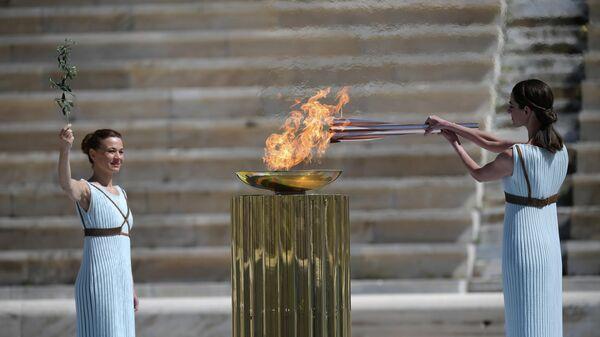 Передача Грецией олимпийского огня оргкомитету XXXII Летних Олимпийских игр Токио-2020.