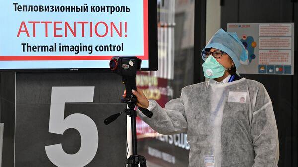Пункт тепловизионного контроля для прилетающих пассажиров в национальном аэропорту Минск