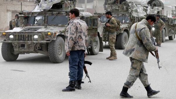 Афганские военные на месте нападения боевиков на храм сикхов в Кабуле. 25 марта 2020 года