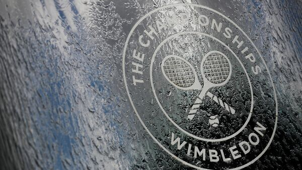 FILE PHOTO: All England Lawn Tennis and Croquet Club, London, Britain - June 30, 2019  General view of the Wimbledon logo   REUTERS/Hannah McKay/File Photo