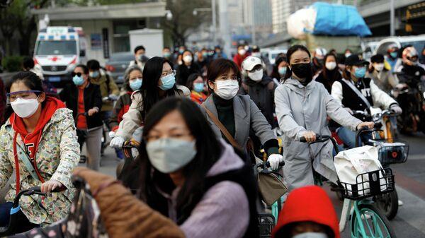 Жители Пекина возвращаются к нормальной жизни