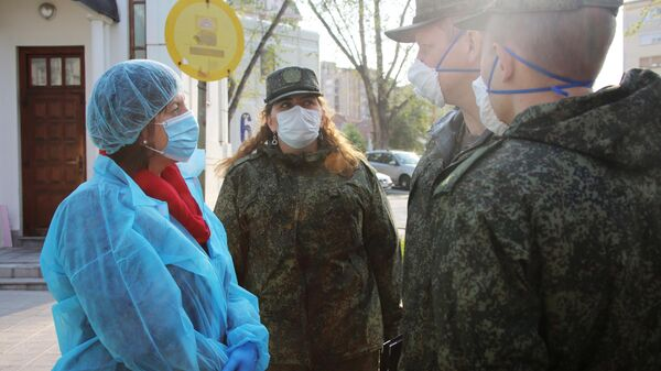 Российские военные специалисты в городе Ниш, где они проводят дезинфекцию медицинских учреждений в связи с эпидемией коронавируса nCoV-2019
