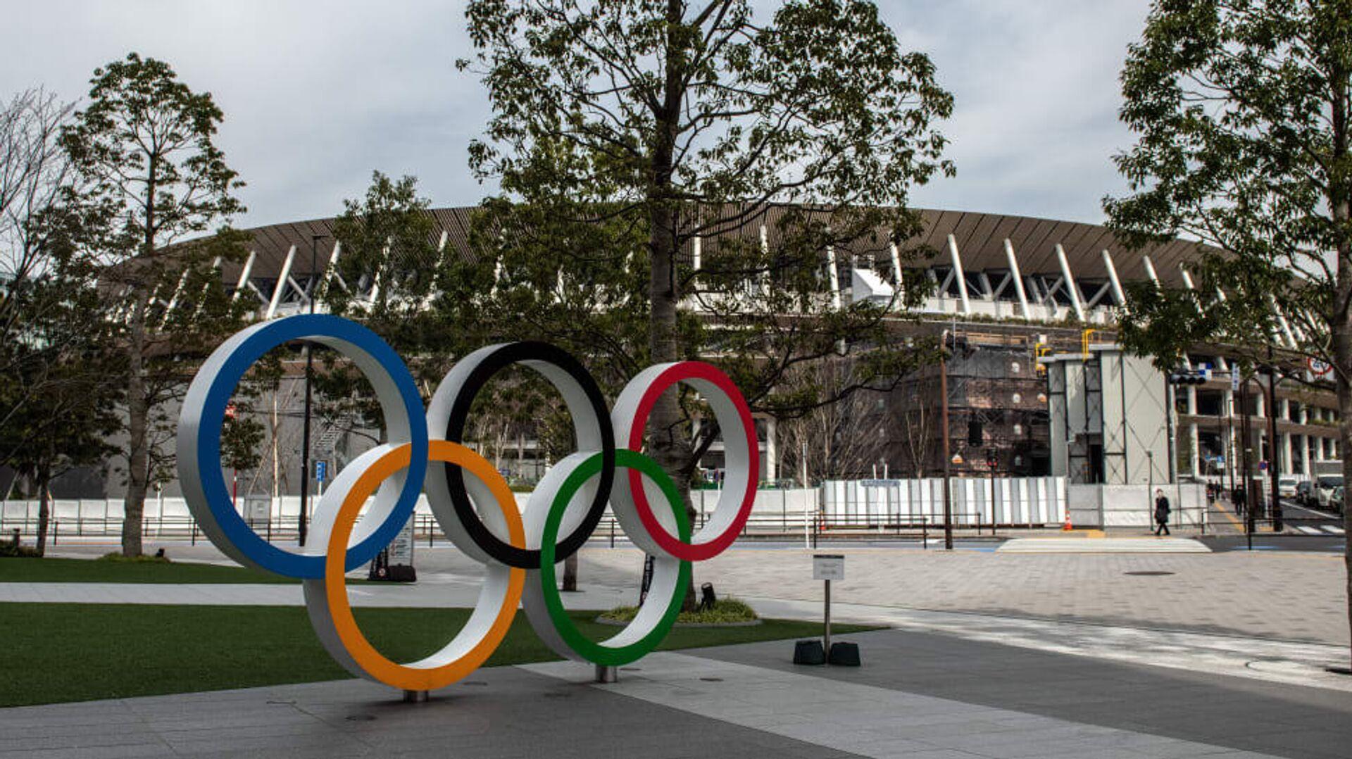 Олимпийские кольца у арены в Токио - РИА Новости, 1920, 24.12.2020