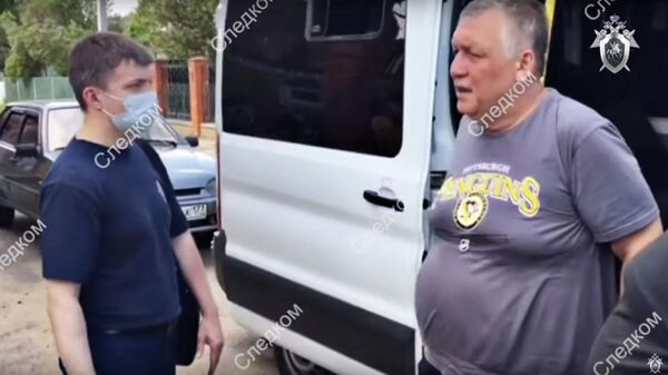 Кадр видео задержания подозреваемого в занятии высшего положения в преступной иерархии в Московской области