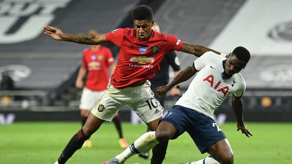 Manchester United's English striker Marcus Rashford (L) vies with Tottenham Hotspur's Ivorian defender Serge Aurier (R) during the English Premier League football match between Tottenham Hotspur and Manchester United at Tottenham Hotspur Stadium in London, on June 19, 2020. - The match ended 1-1. (Photo by Glyn KIRK / POOL / AFP) / RESTRICTED TO EDITORIAL USE. No use with unauthorized audio, video, data, fixture lists, club/league logos or 'live' services. Online in-match use limited to 120 images. An additional 40 images may be used in extra time. No video emulation. Social media in-match use limited to 120 images. An additional 40 images may be used in extra time. No use in betting publications, games or single club/league/player publications. /