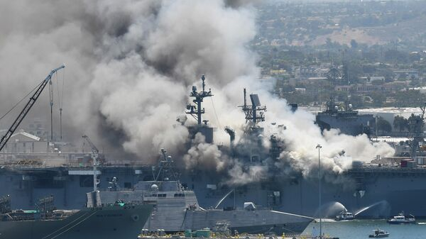 Smoke rises from the USS Bonhomme Richard at Naval Base San Diego Sunday, July 12, 2020, in San Diego after an explosion and fire Sunday on board the ship at Naval Base San Diego
