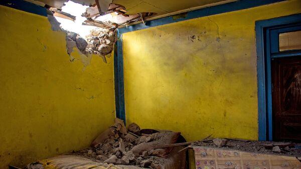 Последствия обстрела на азербайджано-армянской границе в селе Дондар Гушчу Товузского района Азербайджана
