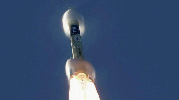 Запуск ракеты-носителя H-2A с космическим зондом Надежда, созданным инженерами ОАЭ, с японского острова Танэгасима