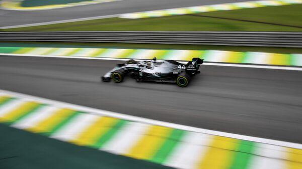 Пилот Формулы-1 Льюис Хэмилтон на Гран-при Бразилии