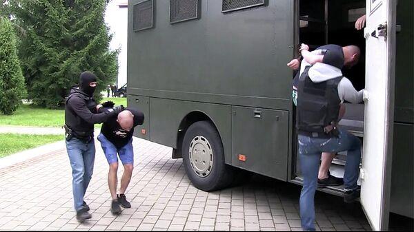 Кадр оперативного видео задержания предположительно 32 членов частной военной компании в Белоруссии