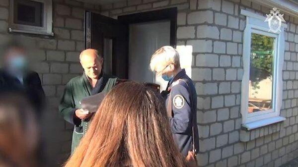 Кадры задержания заместителя главы администрации Троснянского района