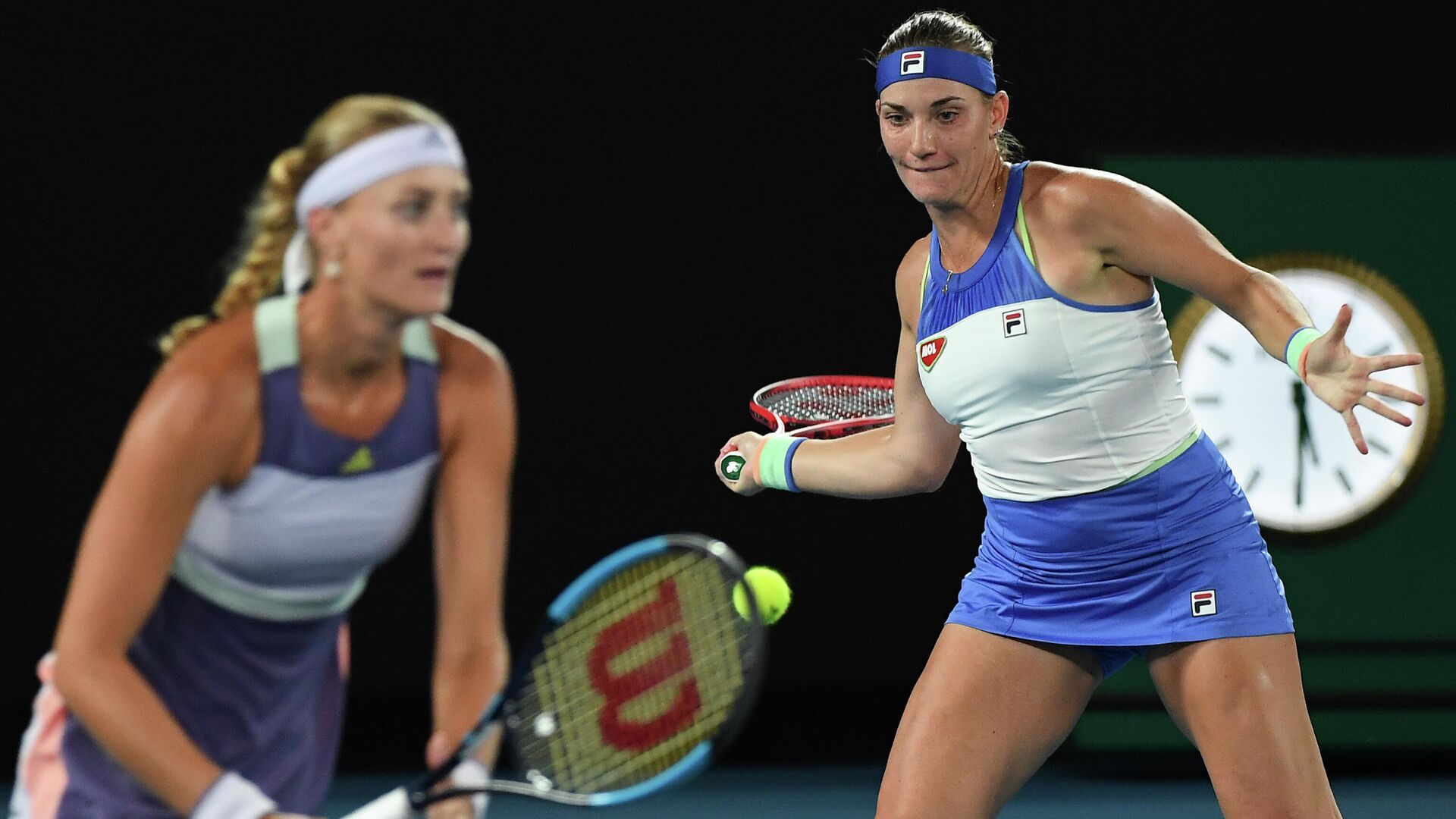Hungary's Timea Babos (R) and France's Kristina Mladenovic (L) play a point against Taiwan's Hsieh Su-wei and Czech Republic's Barbora Strycova during the women's doubles final on day twelve of the Australian Open tennis tournament in Melbourne on January 31, 2020. (Photo by Greg Wood / AFP) / IMAGE RESTRICTED TO EDITORIAL USE - STRICTLY NO COMMERCIAL USE - РИА Новости, 1920, 05.09.2020