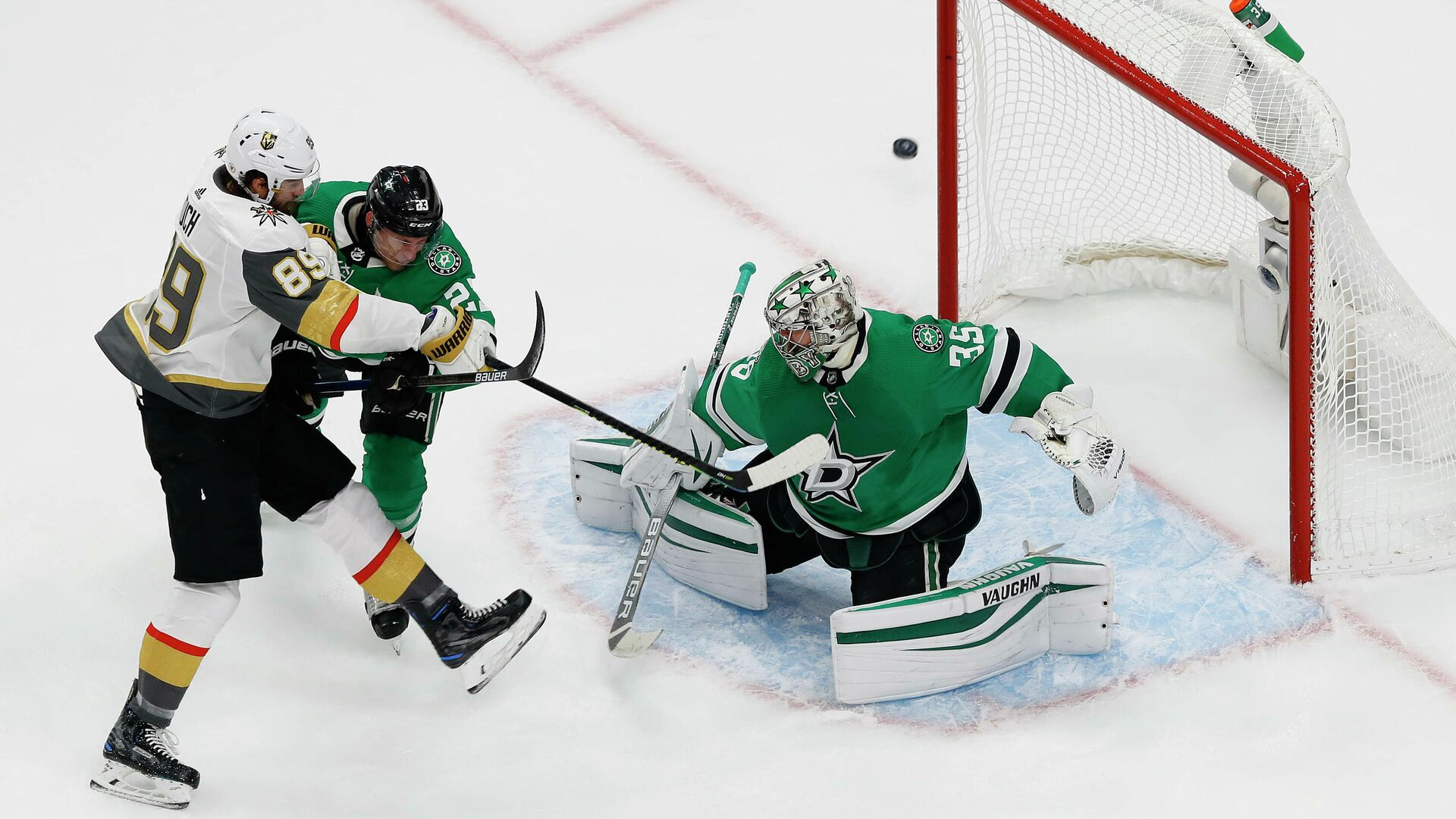 September 12, 2020; Edmonton, Alberta, CAN; Vegas Golden Knights right wing Alex Tuch (89) shoots against the defense of Dallas Stars defenseman Esa Lindell (23) as goaltender Anton Khudobin (35) defends the goal during the first period in game four of the Western Conference Final of the 2020 Stanley Cup Playoffs at Rogers Place. Mandatory Credit: Perry Nelson-USA TODAY Sports - РИА Новости, 1920, 13.09.2020