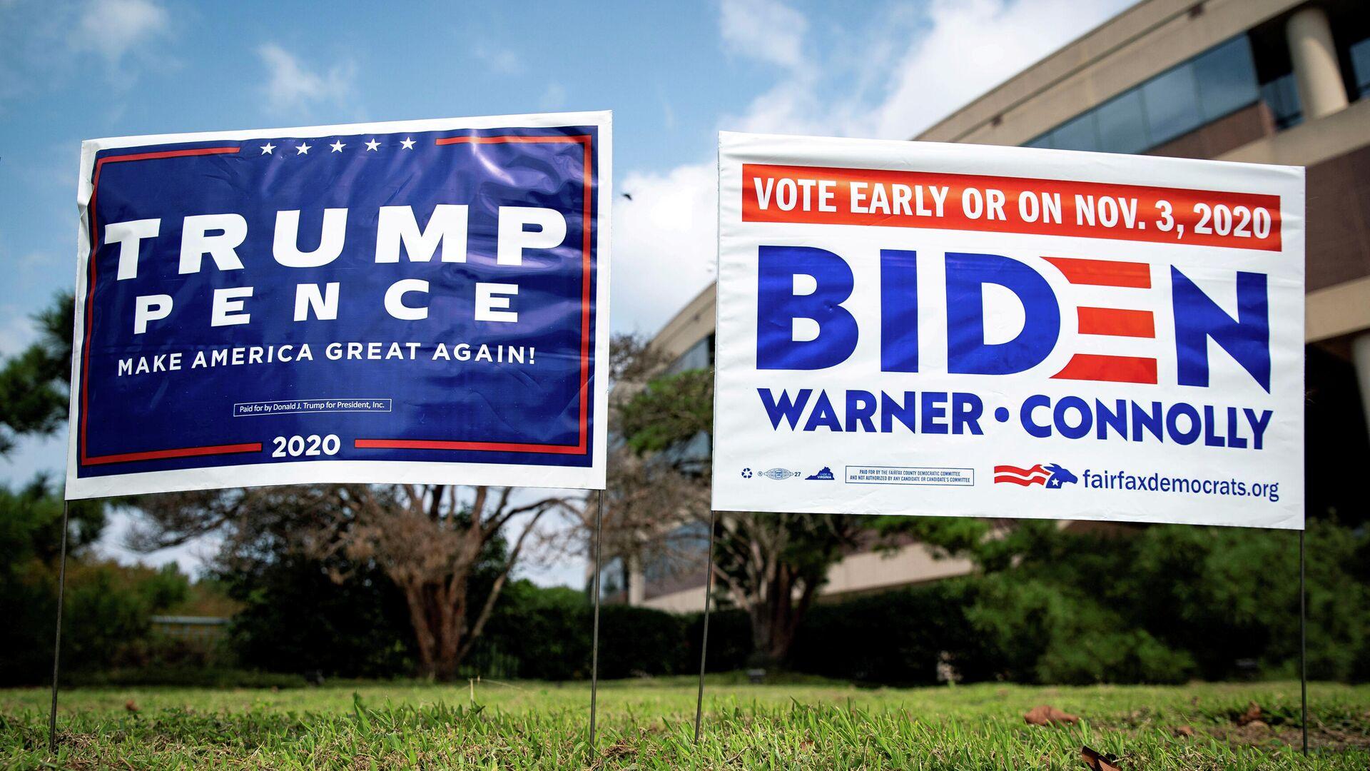 Плакаты в поддержку президента США Дональда Трампа и кандидата в президенты от Демократической партии США Джо Байдена - РИА Новости, 1920, 19.10.2020