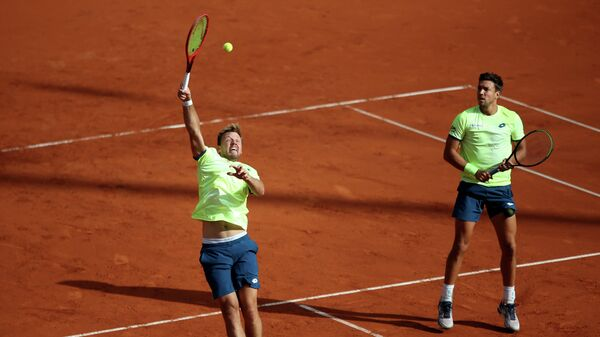 Tennis - ATP 500 - Hamburg European Open - Am Rothenbaum, Hamburg, Germany - September 24, 2020   Germany's Kevin Krawietz and Andreas Mies in action during their men's doubles match against Austria's Oliver Marach and South Africa's Raven Klaasen   REUTERS/Cathrin Mueller
