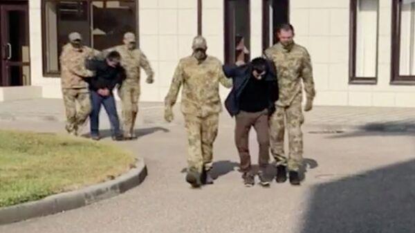ФСБ задержала двух членов банды Шамиля Басаева. Стоп-кадр видео