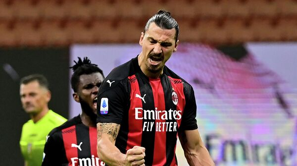 AC Milan's Swedish forward Zlatan Ibrahimovic celebrates after scoring a penalty against AS Roma during the Italian Serie A football match between AC Milan and AS Roma at the Meazza Stadium in Milan on October 26, 2020. (Photo by MIGUEL MEDINA / AFP)