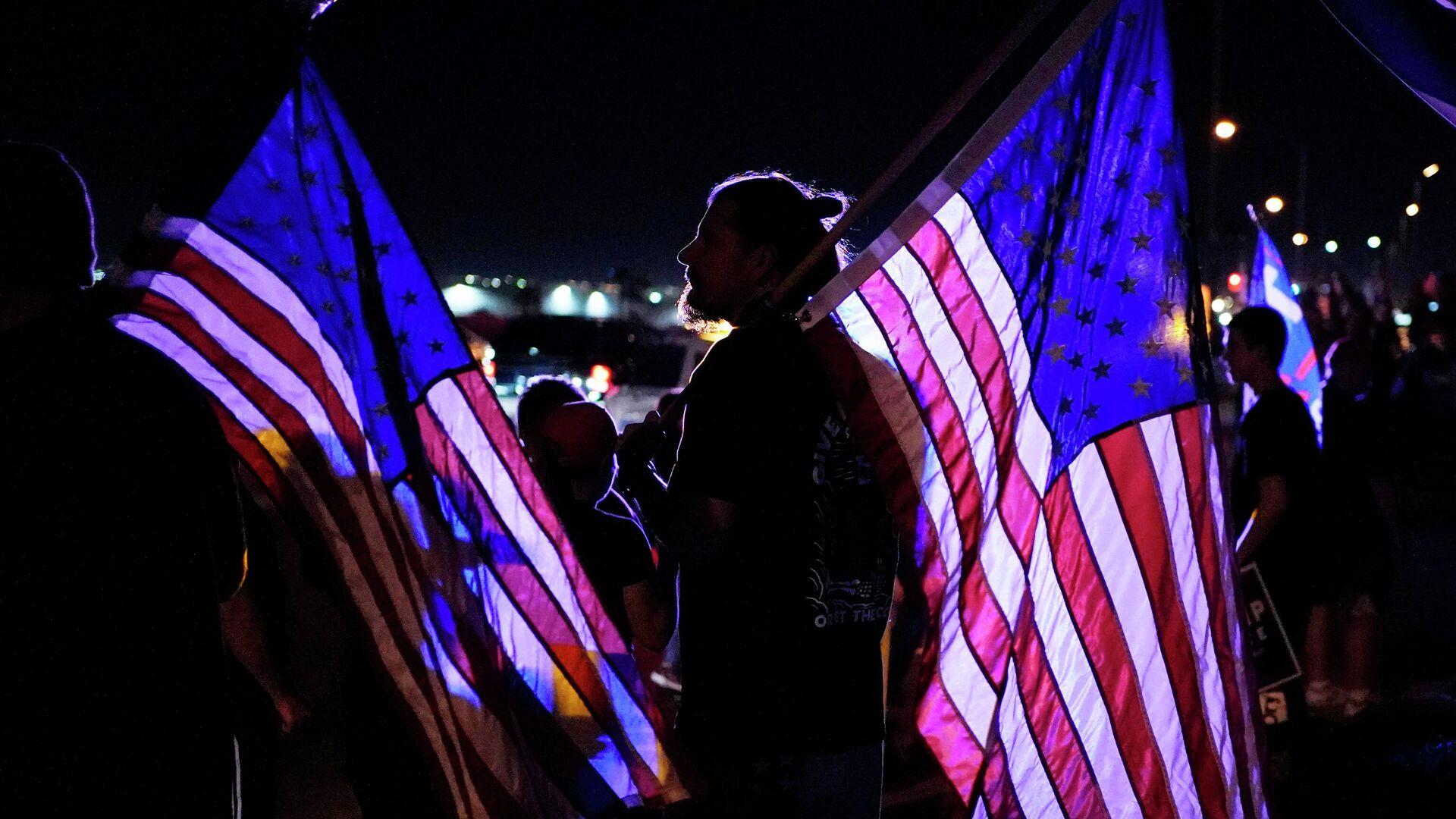 Сторонник президента Дональда Трампа во время акции протест в Лас-Вегасе - РИА Новости, 1920, 08.11.2020