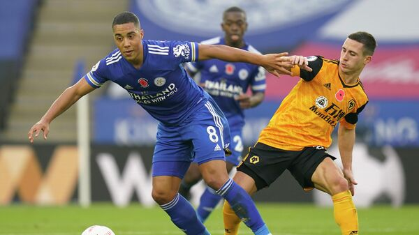 Wolverhampton Wanderers' Portuguese midfielder Daniel Podence (R) vies with Leicester City's Belgian midfielder Youri Tielemans during the English Premier League football match between Leicester City and Wolverhampton Wanderers at King Power Stadium in Leicester, central England on November 8, 2020. (Photo by Tim Keeton / POOL / AFP) / RESTRICTED TO EDITORIAL USE. No use with unauthorized audio, video, data, fixture lists, club/league logos or 'live' services. Online in-match use limited to 120 images. An additional 40 images may be used in extra time. No video emulation. Social media in-match use limited to 120 images. An additional 40 images may be used in extra time. No use in betting publications, games or single club/league/player publications. /