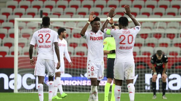 Monaco's French midfielder Aurelien Tchouameni (L) and Monaco's French defender Axel Disasi celebrate after winning the French L1 football match between OGC Nice and AS Monaco FC at The Allianz Riviera Stadium in Nice, south-eastern France on November 08, 2020. (Photo by Valery HACHE / AFP)