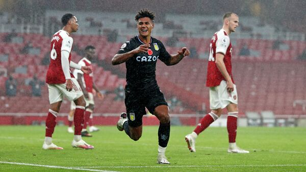 Aston Villa's English striker Ollie Watkins celebrates scoring his team's second goal during the English Premier League football match between Arsenal and Aston Villa at the Emirates Stadium in London on November 8, 2020. (Photo by Alastair Grant / POOL / AFP) / RESTRICTED TO EDITORIAL USE. No use with unauthorized audio, video, data, fixture lists, club/league logos or 'live' services. Online in-match use limited to 120 images. An additional 40 images may be used in extra time. No video emulation. Social media in-match use limited to 120 images. An additional 40 images may be used in extra time. No use in betting publications, games or single club/league/player publications. /