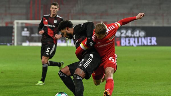 Union Berlin's Norwegian defender Julian Ryerson (R) and Bayern Munich's German midfielder Serge Gnabry vie for the ball during the German first division Bundesliga football match 1 FC Union Berlin vs FC Bayern Munich in Berlin, on December 12, 2020. (Photo by Tobias SCHWARZ / various sources / AFP) / DFL REGULATIONS PROHIBIT ANY USE OF PHOTOGRAPHS AS IMAGE SEQUENCES AND/OR QUASI-VIDEO