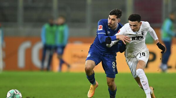 Augsburg's Swiss midfielder Ruben Vargas (R) and Schalke's German midfielder Suat Serdar vie for the ball during the German first division football Bundesliga match FC Augsburg 1907 vs FC Schalke 04 in Augsburg, southern Germany, on December 13, 2020. (Photo by Christof STACHE / various sources / AFP) / DFL REGULATIONS PROHIBIT ANY USE OF PHOTOGRAPHS AS IMAGE SEQUENCES AND/OR QUASI-VIDEO