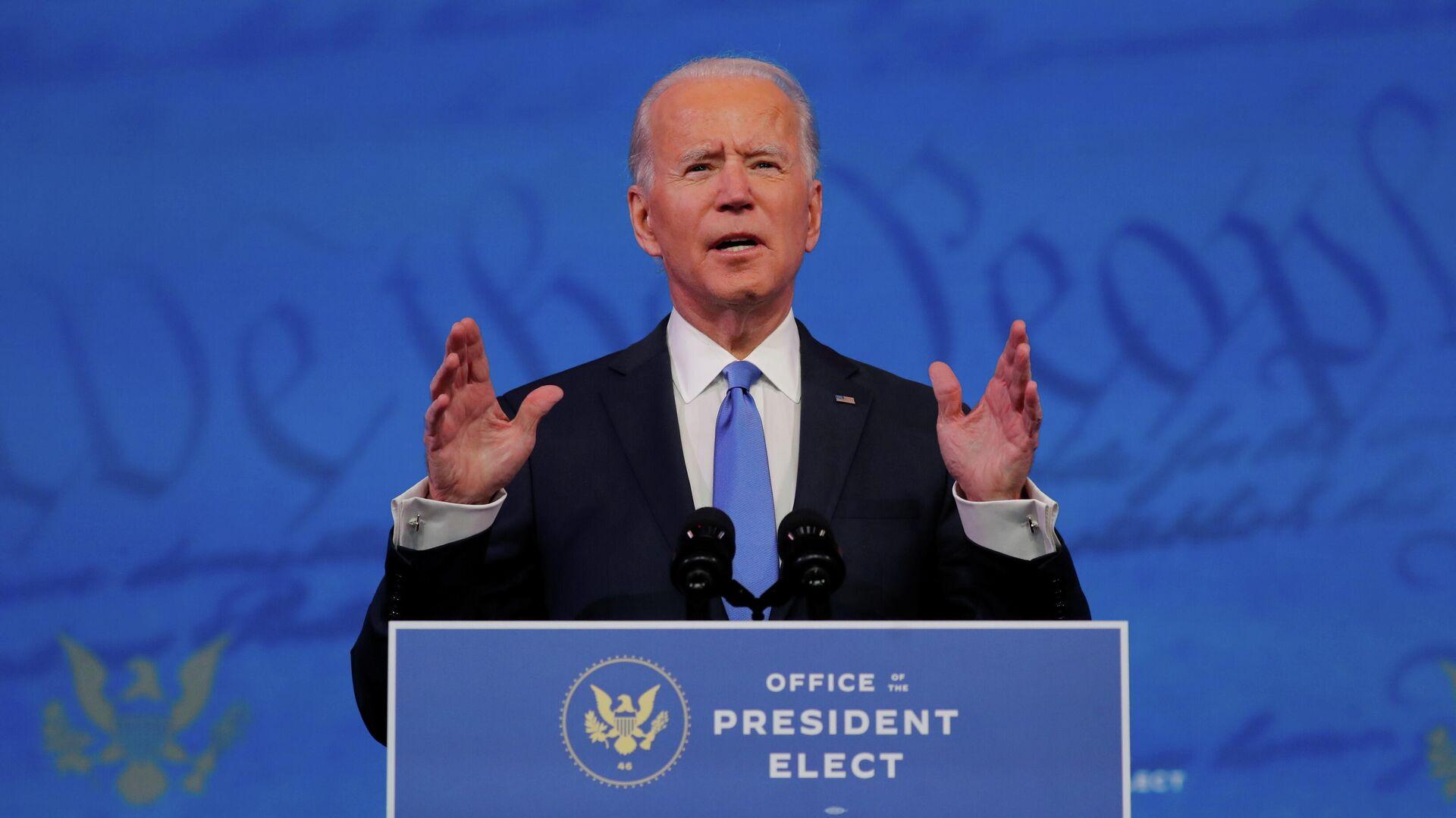 Избранный президент США Джо Байден выступает с телеобращением к нации после того, как Коллегия выборщиков США официально подтвердила его победу на президентских выборах - РИА Новости, 1920, 08.01.2021