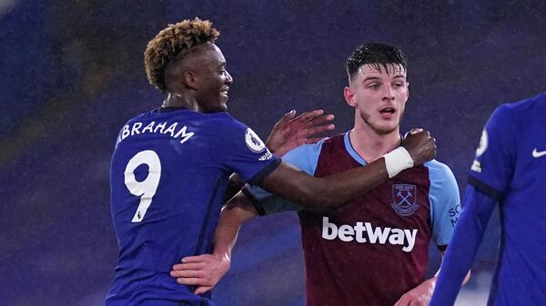 Chelsea's English striker Tammy Abraham (L) speaks with West Ham United's English midfielder Declan Rice (R) on the pitch after the English Premier League football match between Chelsea and West Ham United at Stamford Bridge in London on December 21, 2020. - Chelsea won the game 3-0. (Photo by John Walton / POOL / AFP) / RESTRICTED TO EDITORIAL USE. No use with unauthorized audio, video, data, fixture lists, club/league logos or 'live' services. Online in-match use limited to 120 images. An additional 40 images may be used in extra time. No video emulation. Social media in-match use limited to 120 images. An additional 40 images may be used in extra time. No use in betting publications, games or single club/league/player publications. /