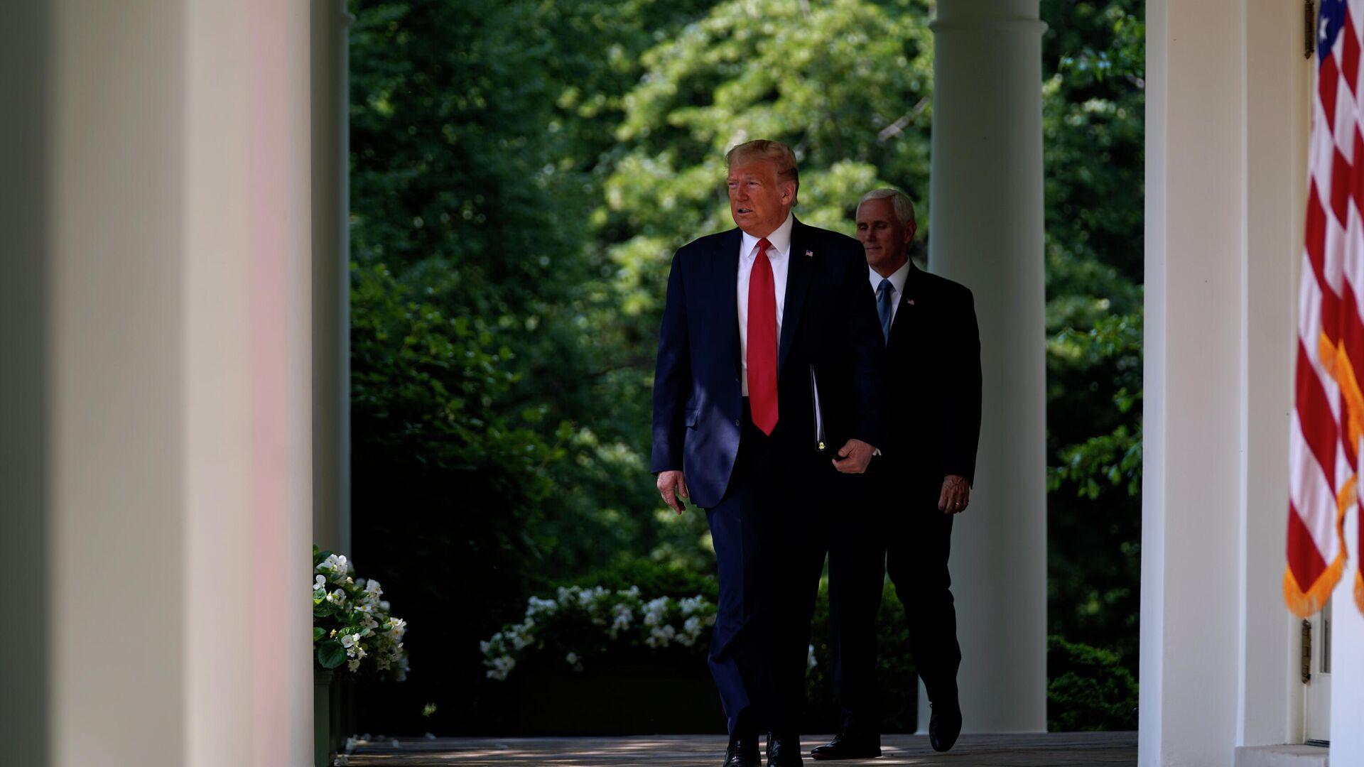 Президент США Дональд Трамп и вице-президент Майк Пенс - РИА Новости, 1920, 05.05.2021