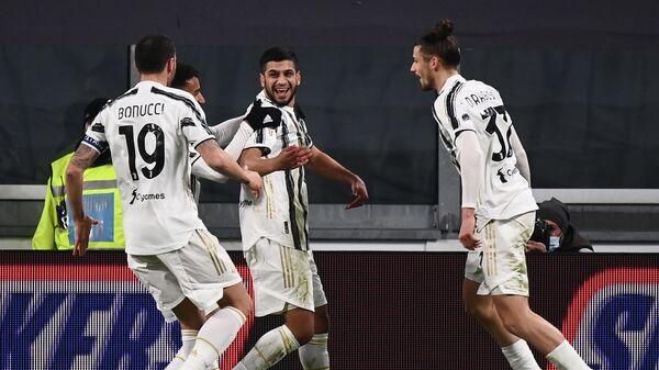 Juventus' Tunisian midfielder Hamza Rafia (C) celebrates after he scored during the Italian Cup (Coppa Italia) round of sixteen football match Juventus vs Genoa on January 13, 2021 at the Juventus stadium in Turin. (Photo by Marco BERTORELLO / AFP)