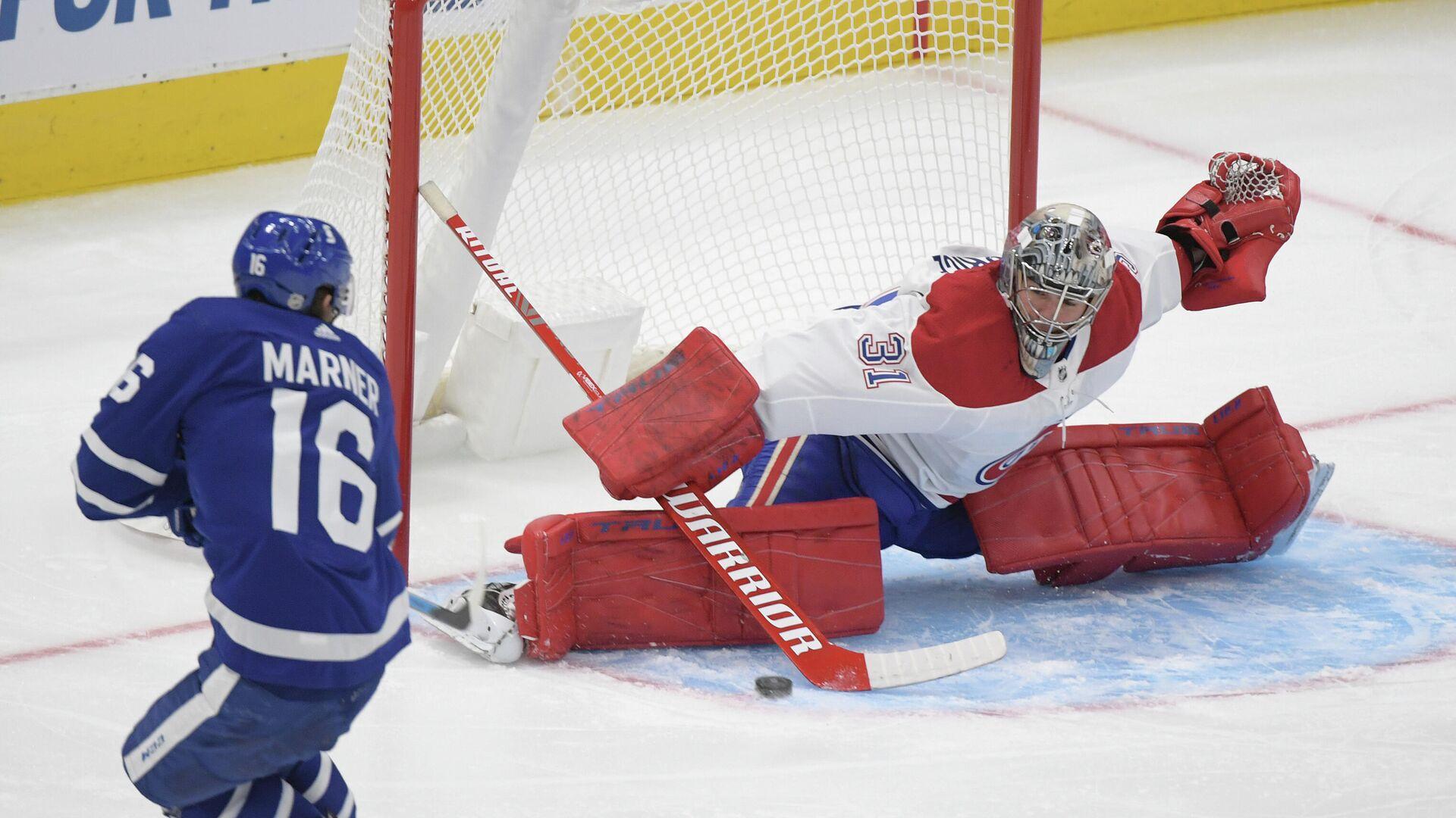 Игровой момент матча НХЛ  Монреаль Канадиенс - Торонто Мейпл Лифс - РИА Новости, 1920, 14.01.2021