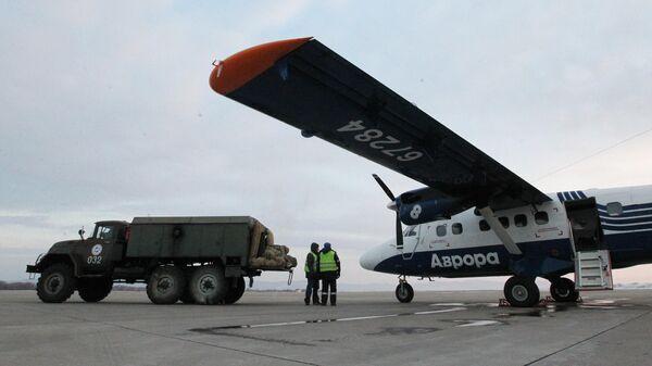 Самолет DHC-6 Twin Otter 400 авиакомпании Аврора в аэропорту Владивостока