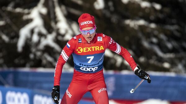 Татьяна Сорина (Россия) на дистанции масс-старта на 10 км свободным стилем среди женщин на соревнованиях по лыжным гонкам Тур де Ски в итальянском Валь-ди-Фьемме.