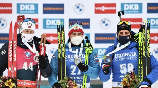 Александр Логинов (в центре),  Стурла Холм Легрейд (слева) и Кентен Фийон Майе