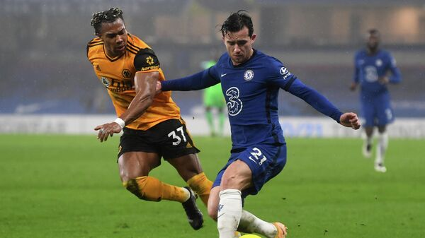 Wolverhampton Wanderers' Spanish midfielder Adama Traore (L) vies with Chelsea's English defender Ben Chilwell during the English Premier League football match between Chelsea and Wolverhampton Wanderers at Stamford Bridge in London on January 27, 2021. (Photo by NEIL HALL / POOL / AFP) / RESTRICTED TO EDITORIAL USE. No use with unauthorized audio, video, data, fixture lists, club/league logos or 'live' services. Online in-match use limited to 120 images. An additional 40 images may be used in extra time. No video emulation. Social media in-match use limited to 120 images. An additional 40 images may be used in extra time. No use in betting publications, games or single club/league/player publications. /
