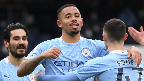 Manchester City's Brazilian striker Gabriel Jesus (C) celebrates scoring the opening goal during the English Premier League football match between Manchester City and Sheffield United at the Etihad Stadium in Manchester, north west England, on January 30, 2021. (Photo by Michael Regan / POOL / AFP) / RESTRICTED TO EDITORIAL USE. No use with unauthorized audio, video, data, fixture lists, club/league logos or 'live' services. Online in-match use limited to 120 images. An additional 40 images may be used in extra time. No video emulation. Social media in-match use limited to 120 images. An additional 40 images may be used in extra time. No use in betting publications, games or single club/league/player publications. /