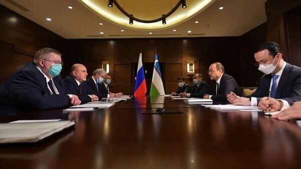 Председатель правительства РФ Михаил Мишустин и премьер-министр Узбекистана Абдулла Арипов во время переговоров в Алматы