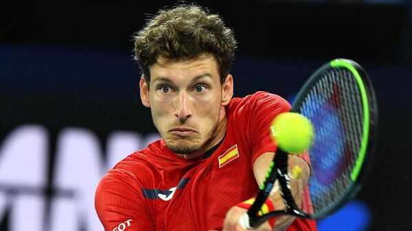 Spain's Pablo Carreno Busta hits a return against Greece's Michail Pervolarakis during their group B ATP Cup singles match in Melbourne on February 5, 2021. (Photo by William WEST / AFP) / -- IMAGE RESTRICTED TO EDITORIAL USE - STRICTLY NO COMMERCIAL USE --