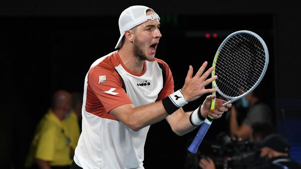 Germany's Jan-Lennard Struff reacts as he plays with Germany's Alexander Zverev against Serbia's Novak Djokovic and Nikola Cacic in their ATP Cup group A men's doubles tennis match in Melbourne on February 5, 2021. (Photo by Paul CROCK / AFP) / -- IMAGE RESTRICTED TO EDITORIAL USE - STRICTLY NO COMMERCIAL USE --