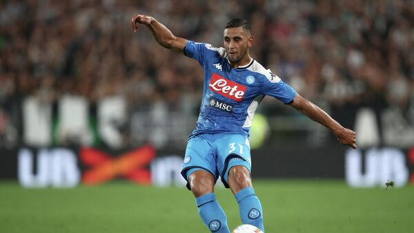 Napoli's Algerian defender Faouzi Ghoulam passes the ball during the Italian Serie A football match Juventus vs Napoli on August 31, 2019 at the Juventus stadium in Turin. (Photo by Isabella Bonotto / AFP)