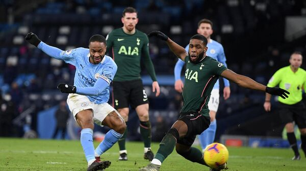 Manchester City's English midfielder Raheem Sterling (L) shoots past Tottenham Hotspur's English midfielder Japhet Tanganga but has his shot saved during the English Premier League football match between Manchester City and Tottenham Hotspur at the Etihad Stadium in Manchester, north west England, on February 13, 2021. (Photo by Shaun Botterill / POOL / AFP) / RESTRICTED TO EDITORIAL USE. No use with unauthorized audio, video, data, fixture lists, club/league logos or 'live' services. Online in-match use limited to 120 images. An additional 40 images may be used in extra time. No video emulation. Social media in-match use limited to 120 images. An additional 40 images may be used in extra time. No use in betting publications, games or single club/league/player publications. /
