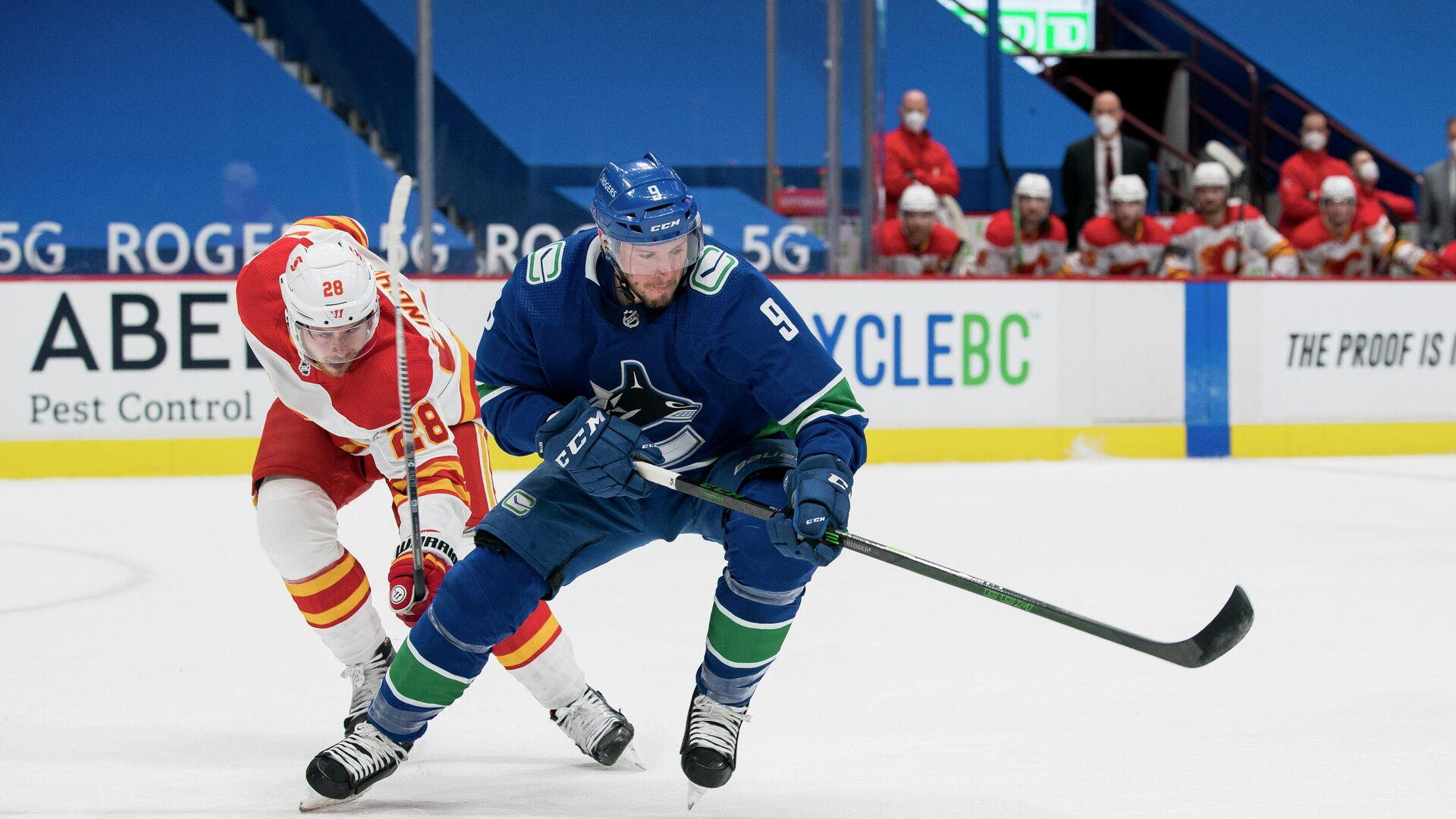 Игровой момент матча НХЛ Ванкувер Кэнакс - Калгари Флэймз - РИА Новости, 1920, 14.02.2021