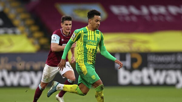West Bromwich Albion's Brazilian midfielder Matheus Pereira runs with the ball during the English Premier League football match between Burnley and West Bromwich Albion at Turf Moor in Burnley, north west England on February 20, 2021. (Photo by Clive Brunskill / POOL / AFP) / RESTRICTED TO EDITORIAL USE. No use with unauthorized audio, video, data, fixture lists, club/league logos or 'live' services. Online in-match use limited to 120 images. An additional 40 images may be used in extra time. No video emulation. Social media in-match use limited to 120 images. An additional 40 images may be used in extra time. No use in betting publications, games or single club/league/player publications. /