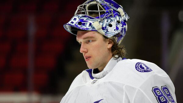RALEIGH, NORTH CAROLINA - FEBRUARY 22: Andrei Vasilevskiy #88 of the Tampa Bay Lightning looks on during the first period of their game against the Carolina Hurricanes at PNC Arena on February 22, 2021 in Raleigh, North Carolina.   Jared C. Tilton/Getty Images/AFP (Photo by Jared C. Tilton / GETTY IMAGES NORTH AMERICA / Getty Images via AFP)