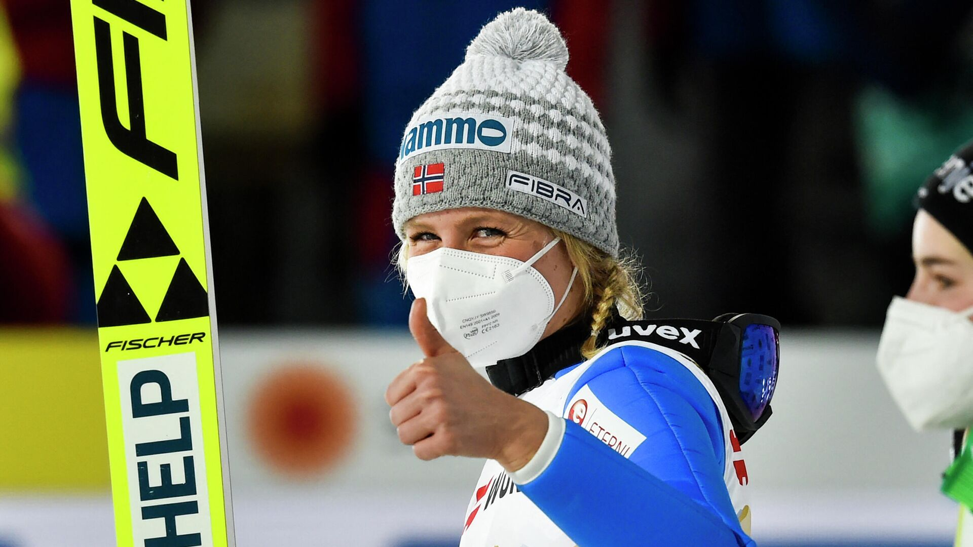 Norway's Maren Lundby give a thumbs up after winning the women's HS137 large hill jumping event at the FIS Nordic Ski World Championships in Oberstdorf, southern Germany, on March 3, 2021. (Photo by Christof Stache / AFP) - РИА Новости, 1920, 03.03.2021