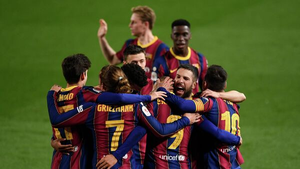 Barcelona players celebrate their third goal scored by Barcelona's Danish forward Martin Braithwaite during Spanish Copa del Rey (King's Cup) semi-final second leg football match between FC Barcelona and Sevilla FC at the Camp Nou stadium in Barcelona on March 3, 2021. (Photo by Josep LAGO / AFP)