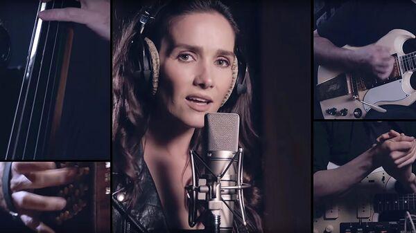 Кадр из клипа Bajofondo, Natalia Oreiro - Будем танцевать